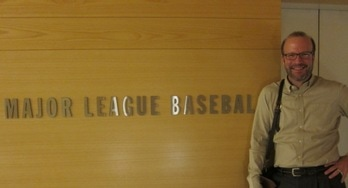 Photograph of Donald Gault consulting in the offices of the Commissioner of Major League Baseball